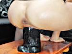 Sarah devours a giant dildo